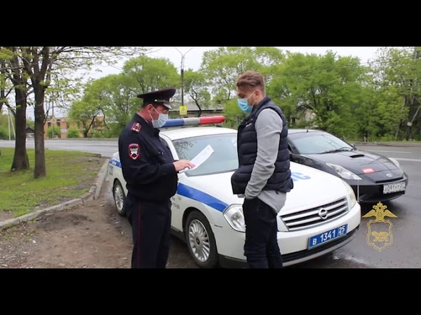 Полиция оштрафовала уссурийского супермена и водителя который прокатил его на крыше авто